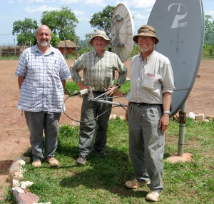Dan and fellow HCJB engineers with dish to receive French broadcasts
